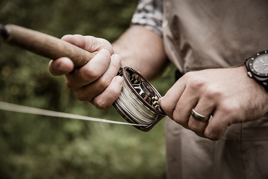 Preparing a fly rod for fishing in Maine