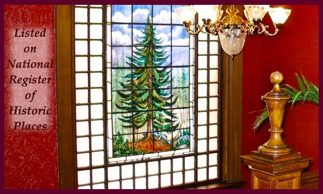 Original 1890 hand-painted leaded glass window of blue spruce tree still adorns the staircase