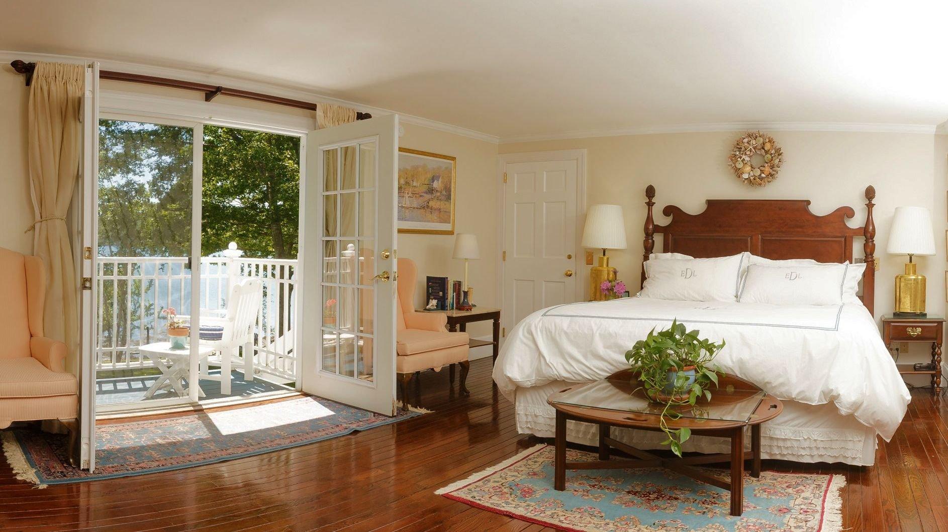 Master bedroom with French door and deck overlooking the ocean. Sea breezes. Ocean moonrises. (In the evenings, deer gather on the lawn below).