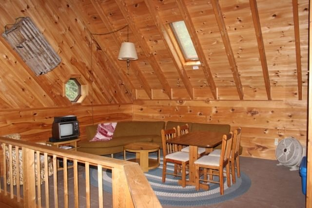 Upstairs Loft (3rd Living Room) with wraparound couch; to right of open loft area at Duck Cove Cottage