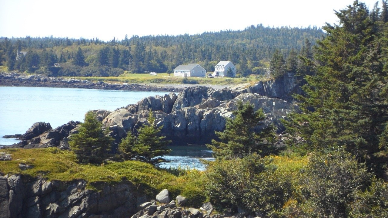 Eagles Rest is the cottage on the left closest to the shore. The owner's home is on the right.