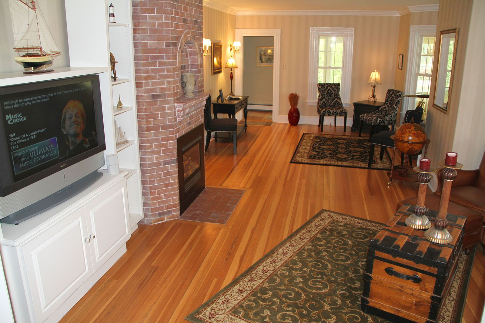 Living Room with Entertainment System and Gas Fireplace.  See much more at www.luxurykennebunkporthouserental.com