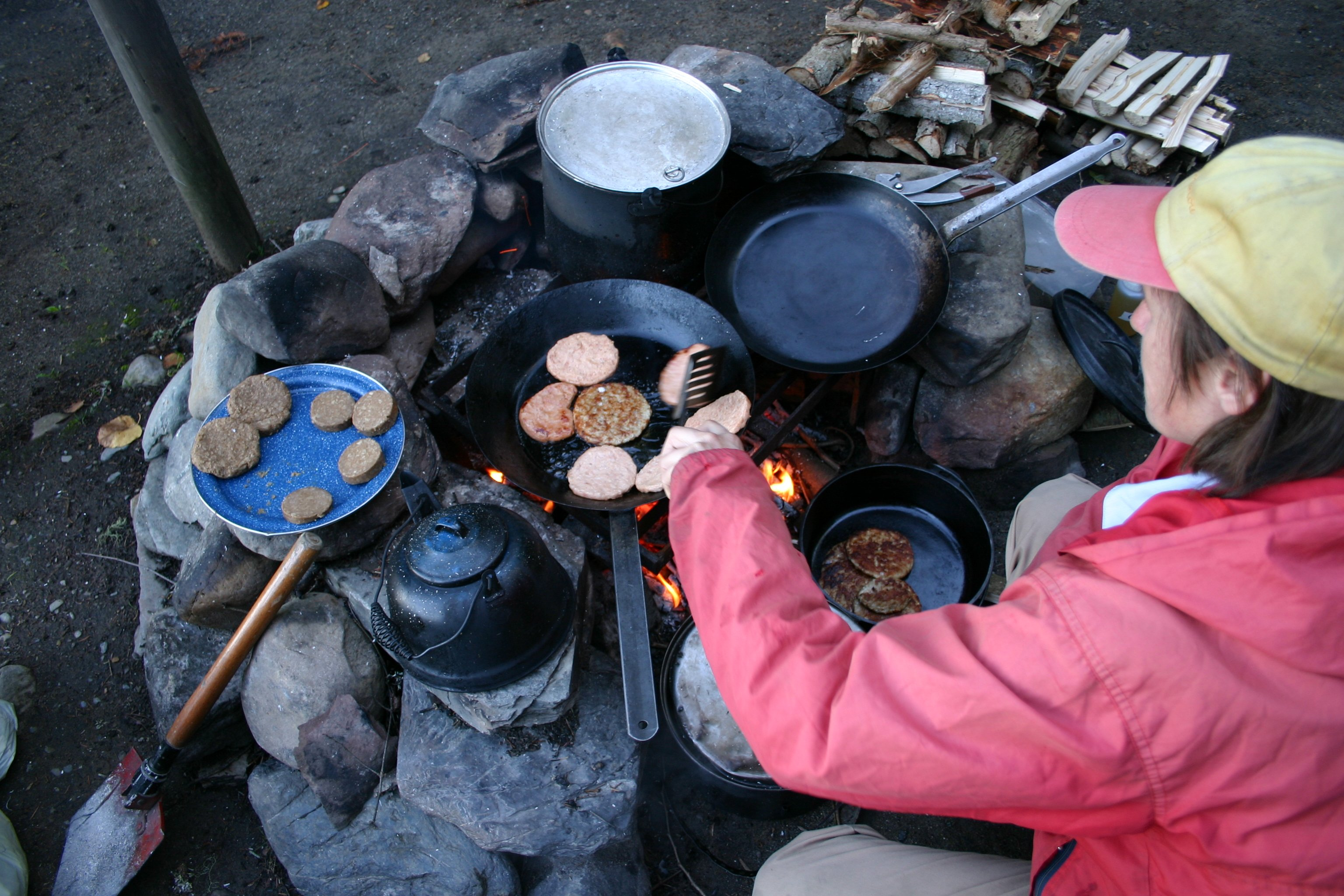 Polly fixing up a campfire breakfast.