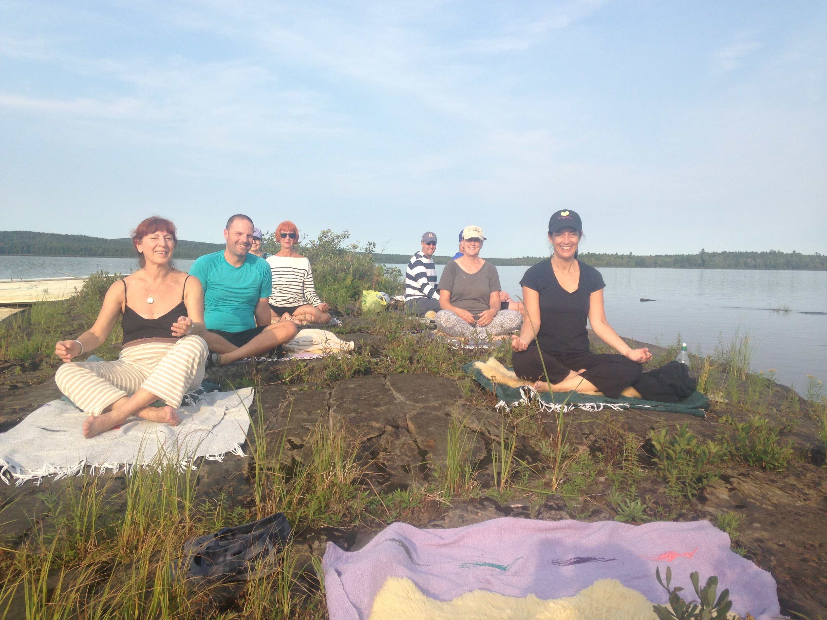 yoga on Loon Ledge in the middle of the lake 5 miles away from civilization- fun outings for yoga, meditation and swimming too!
