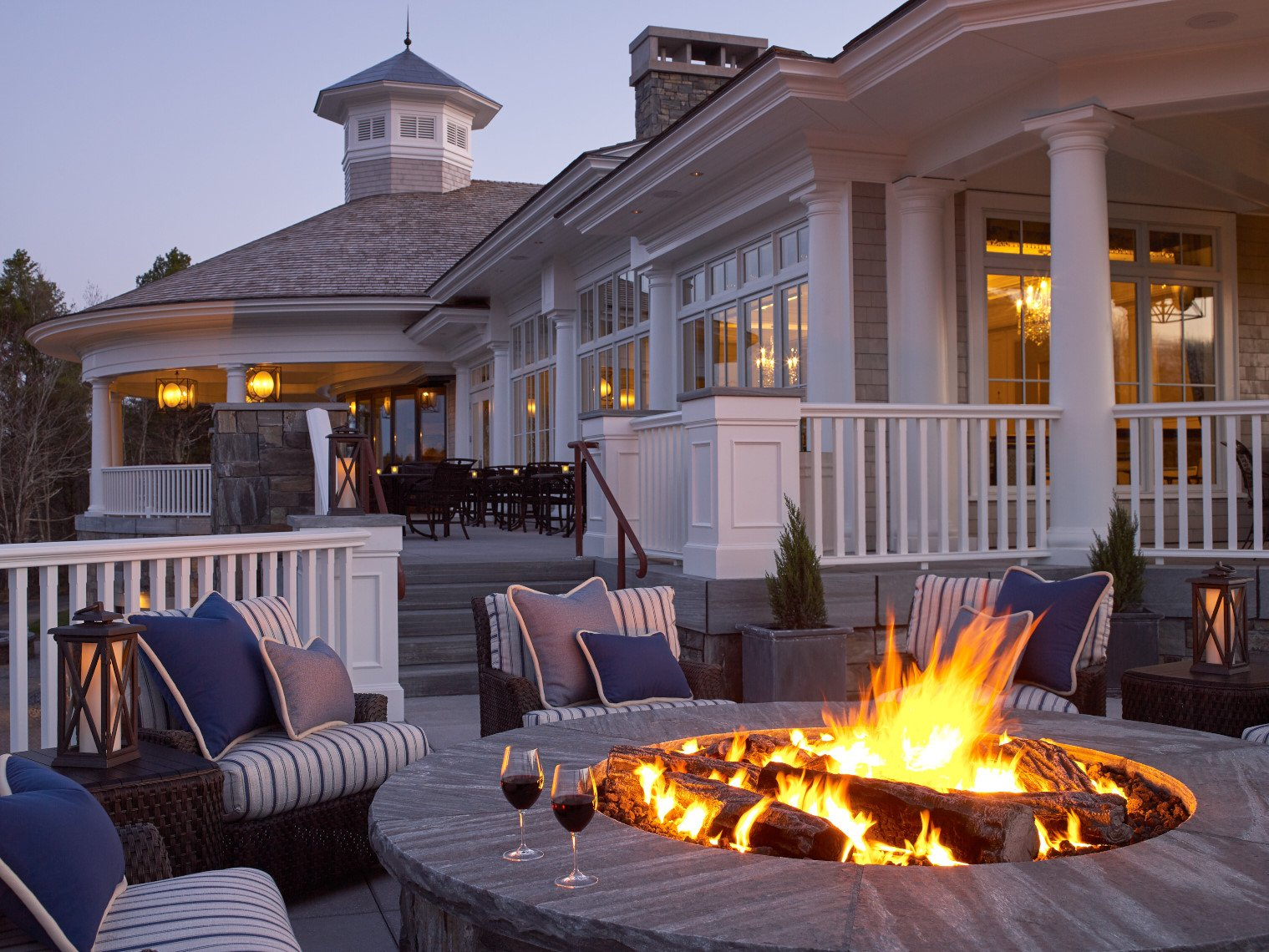 Enjoy a glass of wine and appetizers by our firepit with family & friends