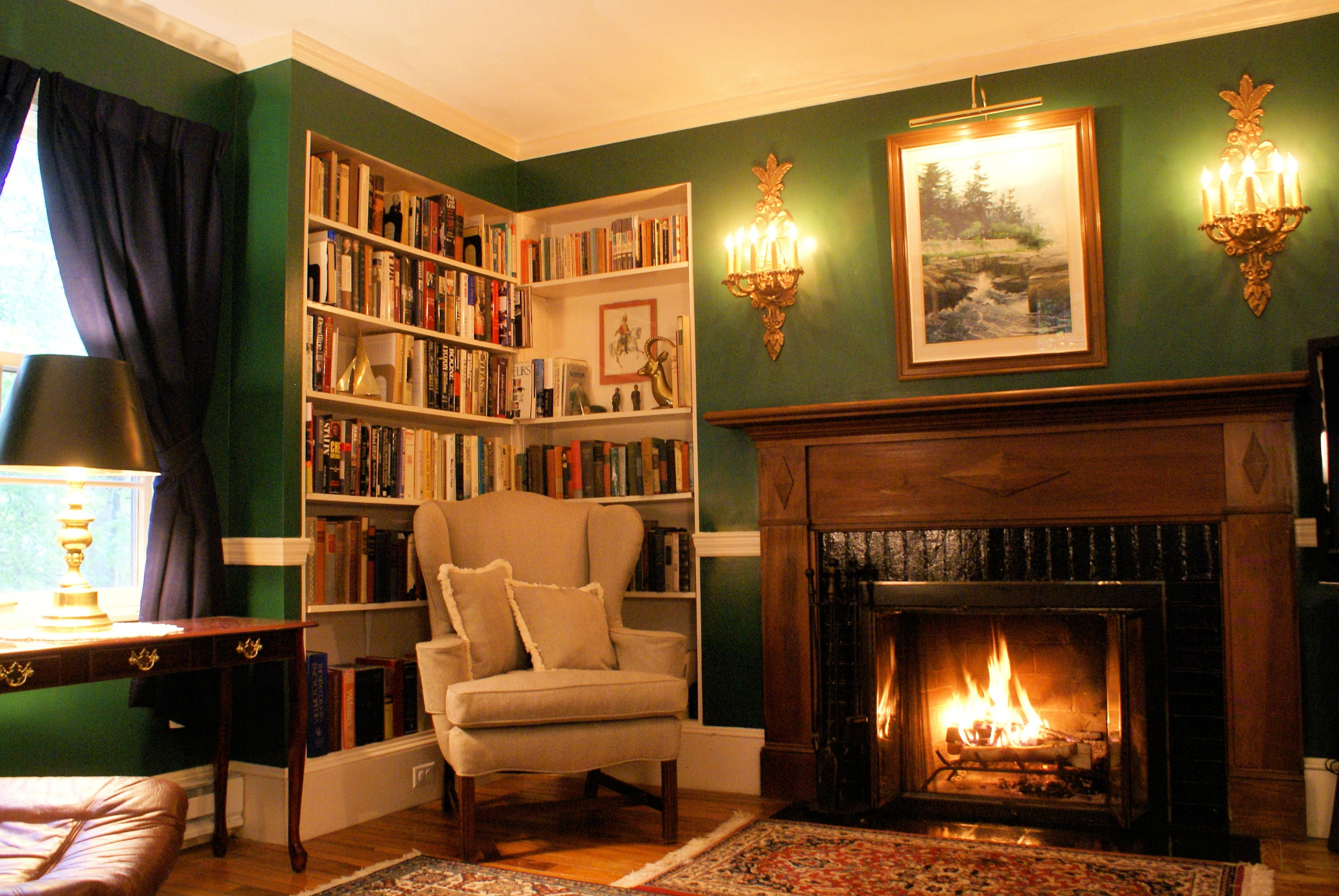 Library. Antiques (Astor wall sconces). Military history collectibles. Oriental rugs, leather seating. Drapes are Maine flags.