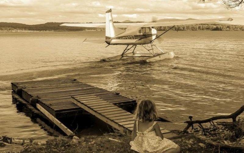girl watching a float plane