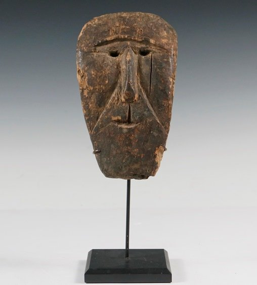 Rare 19th c. or earlier carved shamanic mask on metal museum stand, one of many fine Inuit items included in Thomaston Place Auction Galleries' Winter 2018 auction.