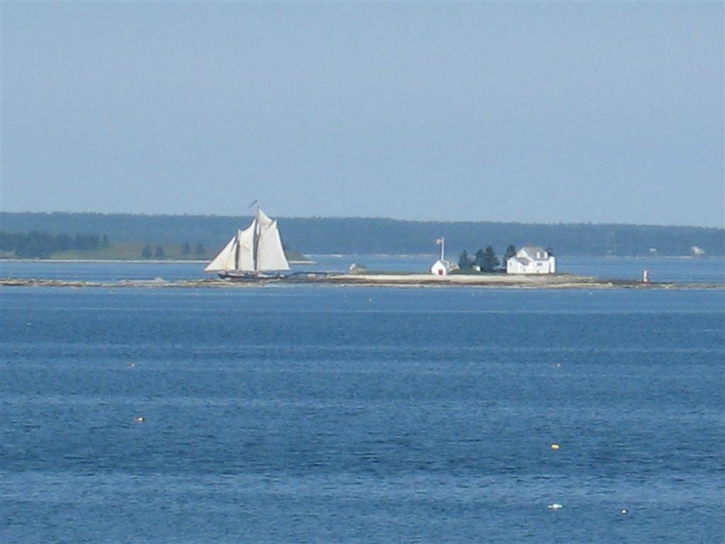 close-up of schooner sailing past the Blue Hill Bay Lighthouse