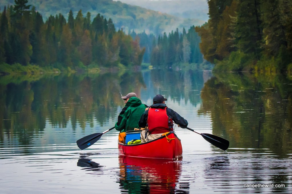 Paddling a canoe on the Allagash Wilderness Waterway