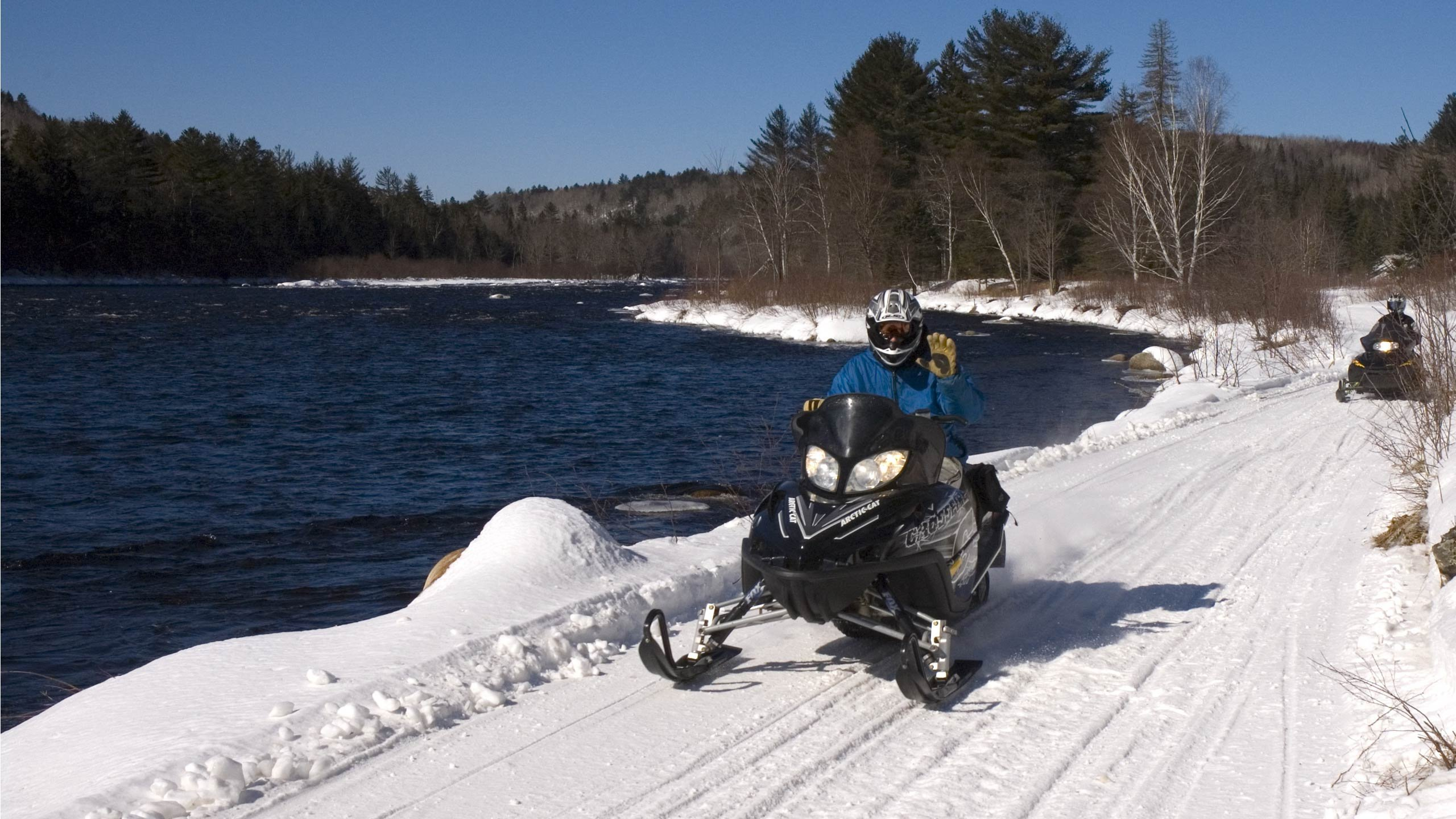 Blue sky riding day along the Kennebec River.