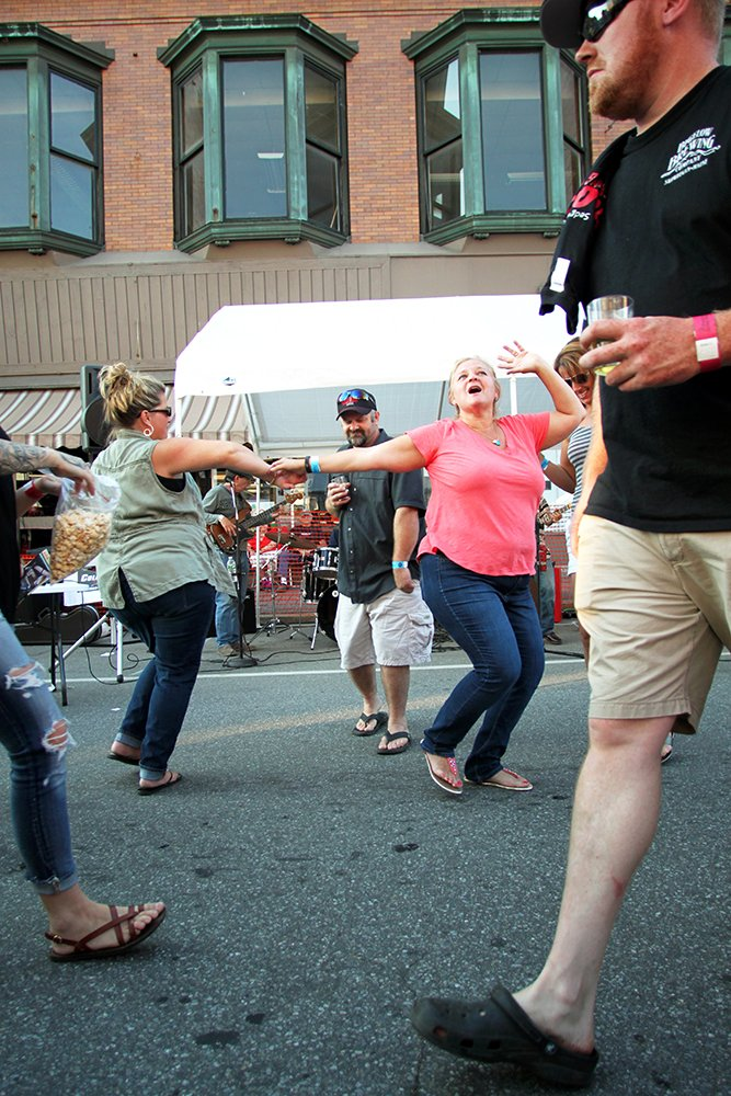 With music, beer, and good times flowing, some festival-goers took to dancing in the street during the 2016 brew fest.