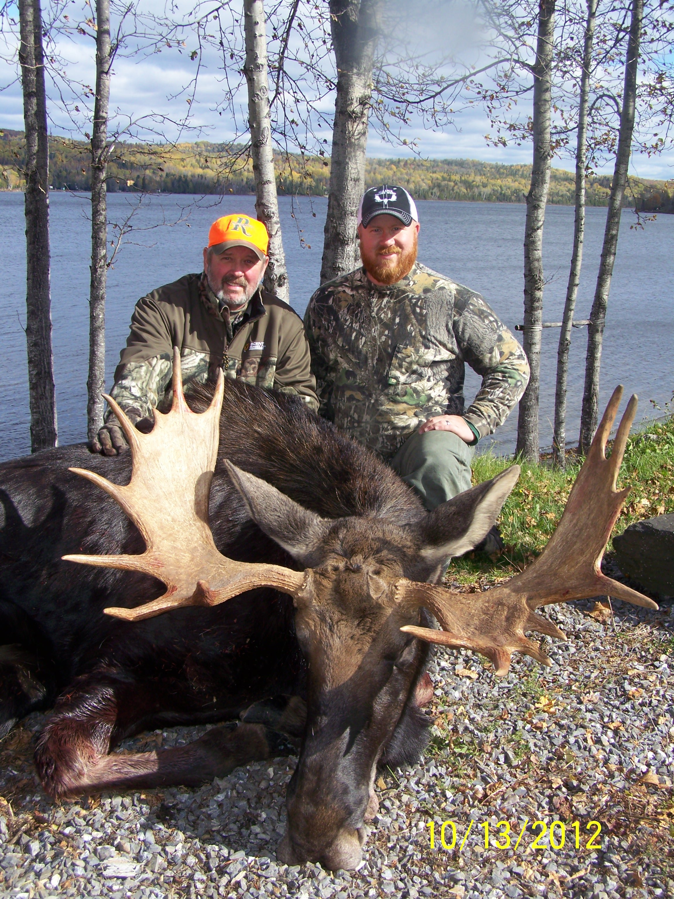 Father and son with a trophy bull.