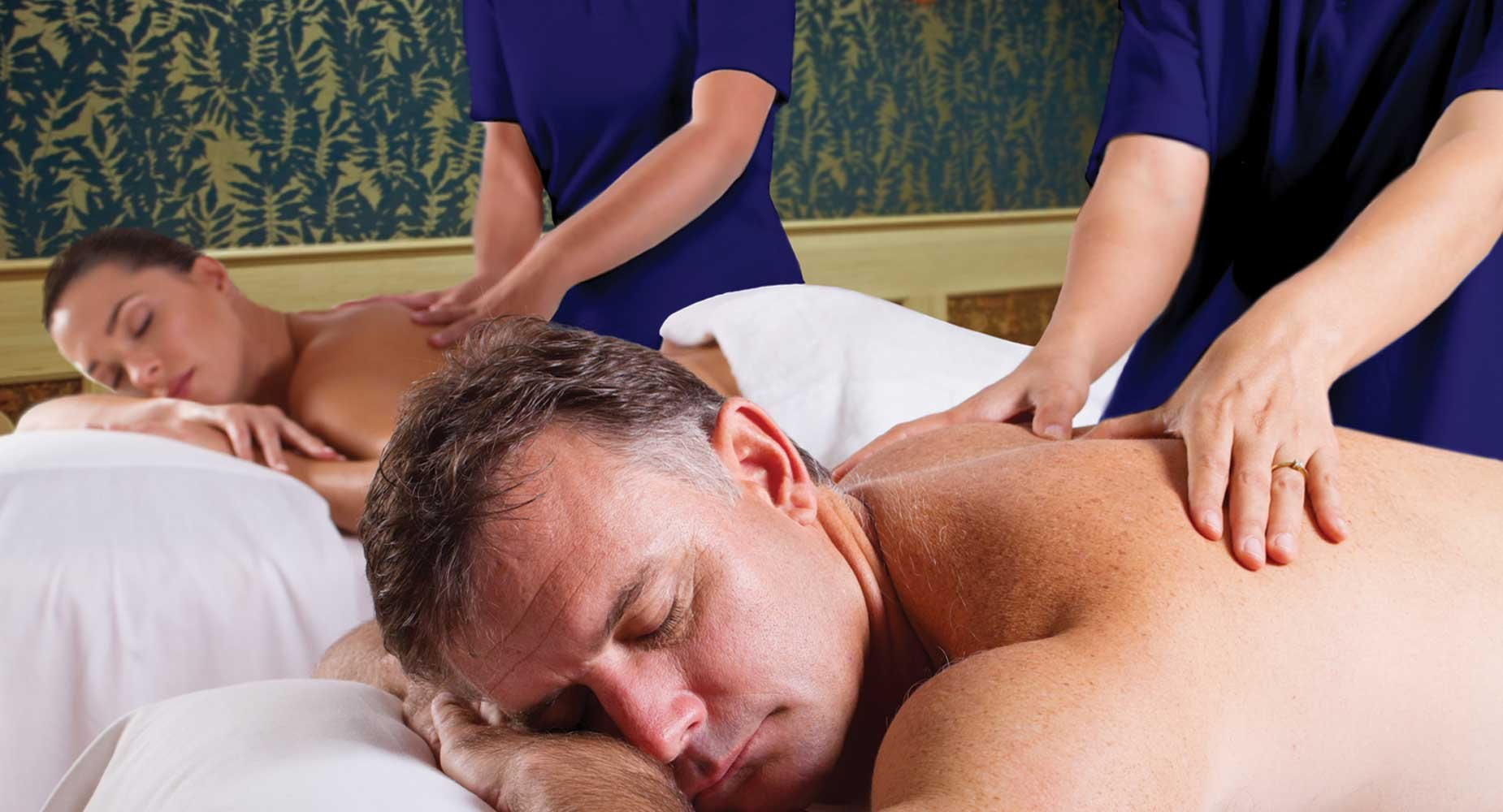 Schedule a couple's massage.The room is warmly decorated with teals and golds ... very inviting.