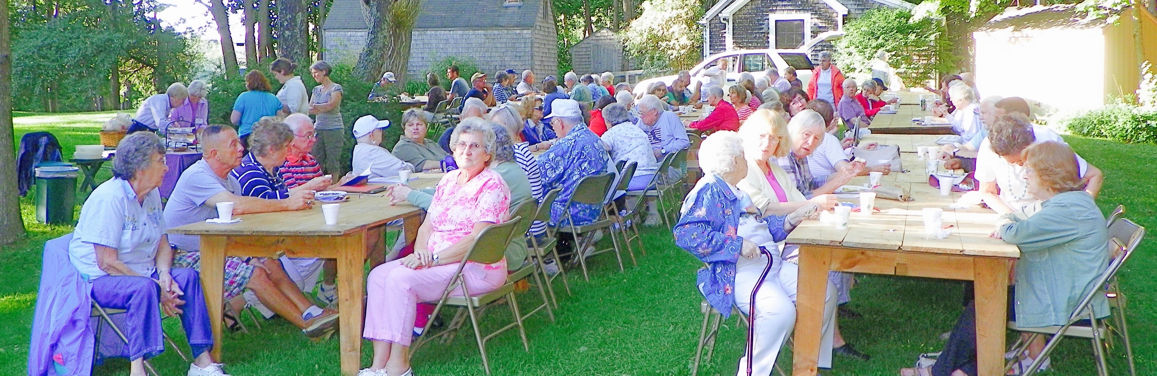 Happy people enjoying a Bean hole bean supper, aine yellow-eyed beans cooked underground the old-fashioned way - run out. Menu: beans, Kirshner hot dog, coleslaw, biscuits with real butter and a pickle or two,