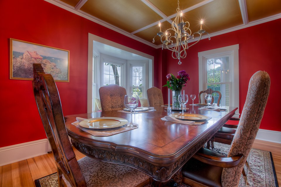 Dining Room Table with Gold Ceilings seats 12.  See much more at www.luxurykennebunkporthouserental.com