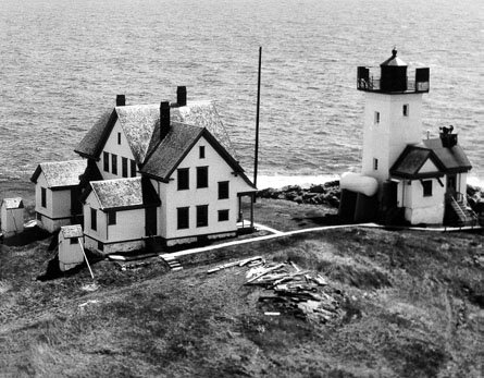 Historic photo of Two Bush Island Light Station. Only the square light tower remains today.