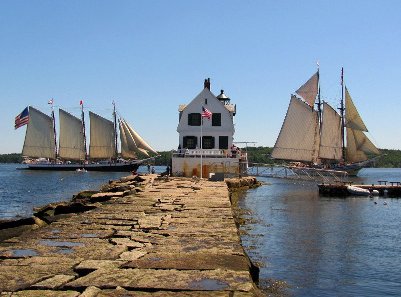 Windjammers sail past the Rockland Breakwater Light
