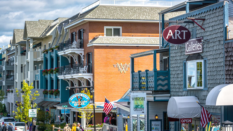 Shops and restaurants line the streets along the harbor.