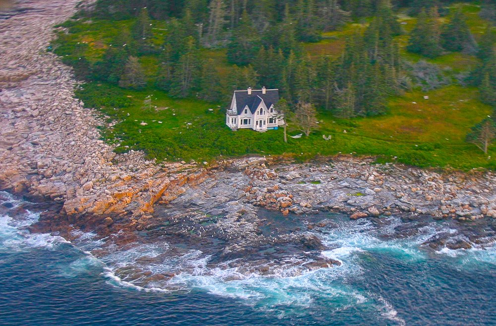 From this aerial view you can see the house at the edge of the sea.