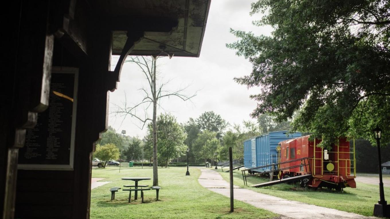 Train cars are a colorful accent for the Railroad Memorial Pavilion, which holds the names of L&N R/R workers from the past. – Cari Griffith