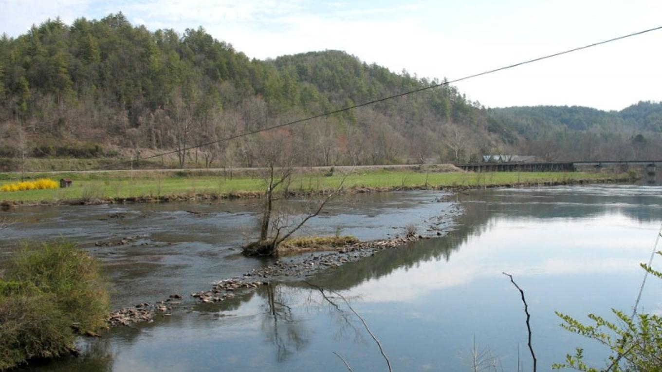 A Cherokee fish trap can still be seen in the Hiwassee River outside the store. The railroad bridge can be seen at right. – Ingrid Buehler