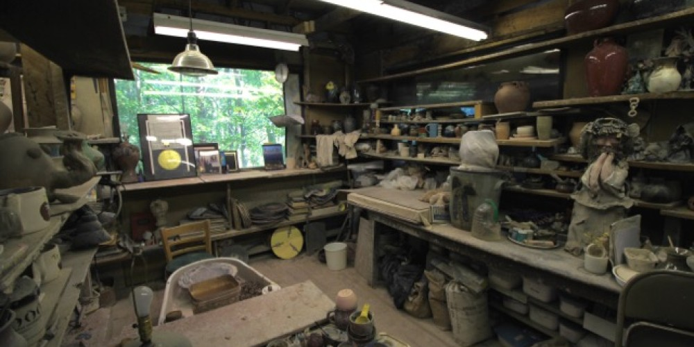 Our studio sits in one building with interior shelves filled with unglazed mugs, stoneware, and whimsical collectibles. – Jacob Resor