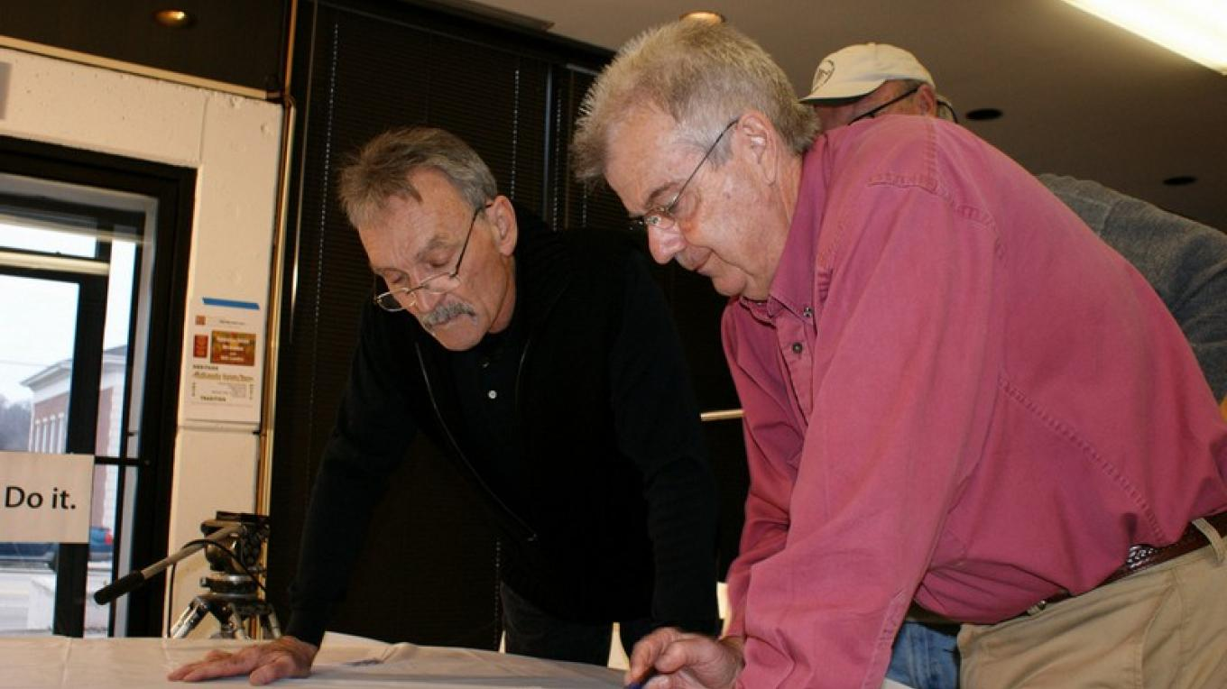 Muse Watson (actor) and Gary Baker (business man) pour over architectural drawings of the planned restoration project. – J. Paul Mashburn