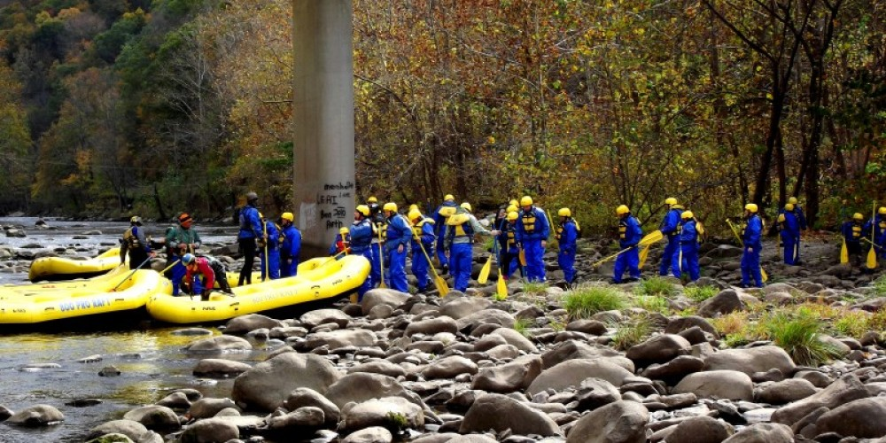 """This photo is of a """"Group who went Rafting in the Smokies this fall, we provide Splash suites so that you stay dry and comfortable. Come see the Fall colors from the rivers point of view."""