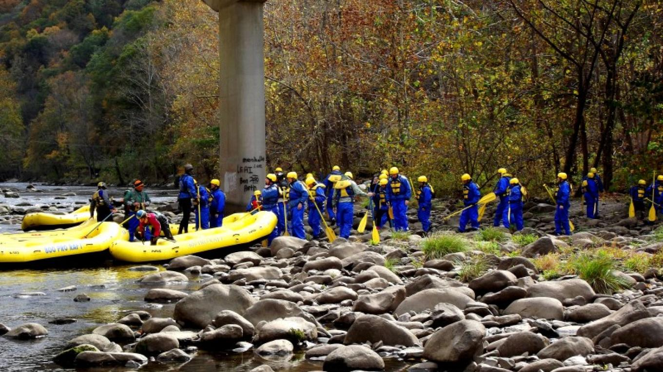 "This photo is of a ""Group who went Rafting in the Smokies this fall, we provide Splash suites so that you stay dry and comfortable. Come see the Fall colors from the rivers point of view."