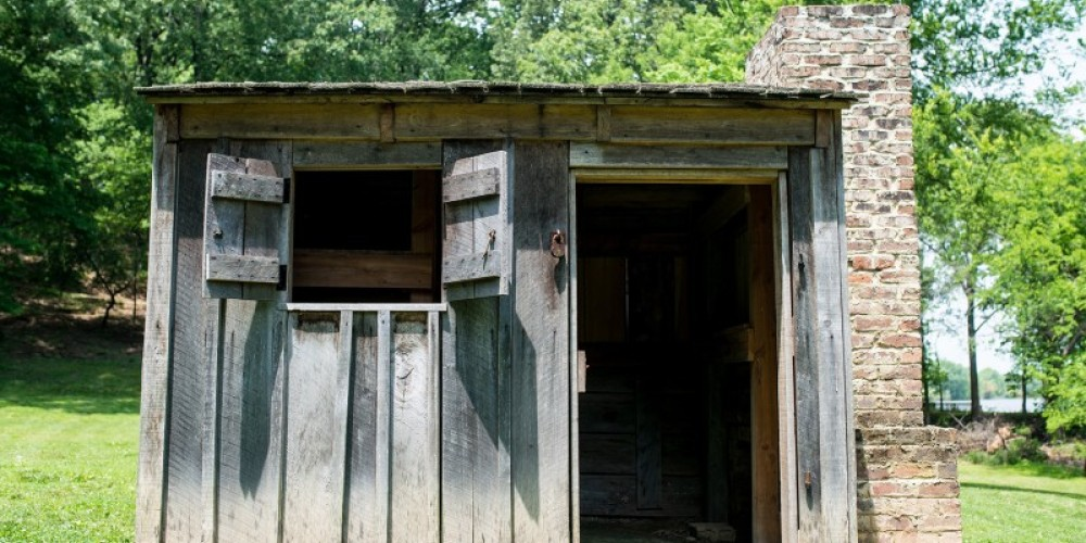 Soldiers had many types of housing. Some, like this hut, included a fireplace, wooden shingles and board and batten walls. – Cari Griffith