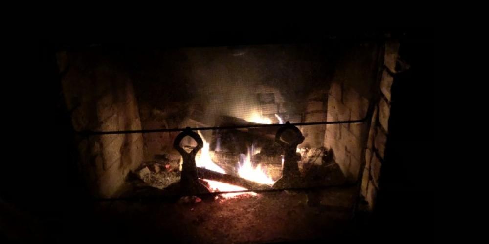 Romantic fireplace at night. – Susan Jones