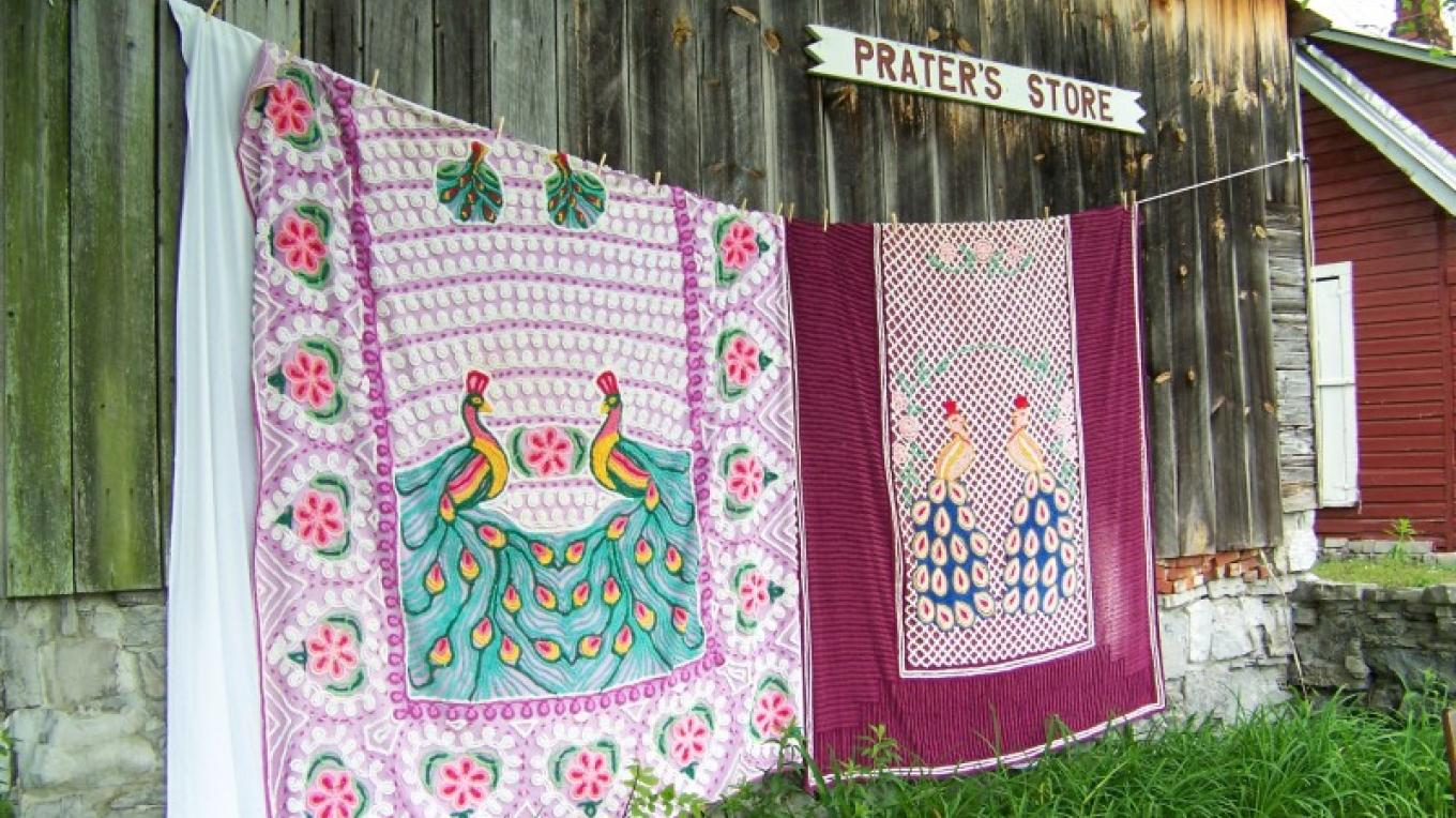 Peacock-designed chenille bedspreads help the Fair celebrate the area's textile heritage.