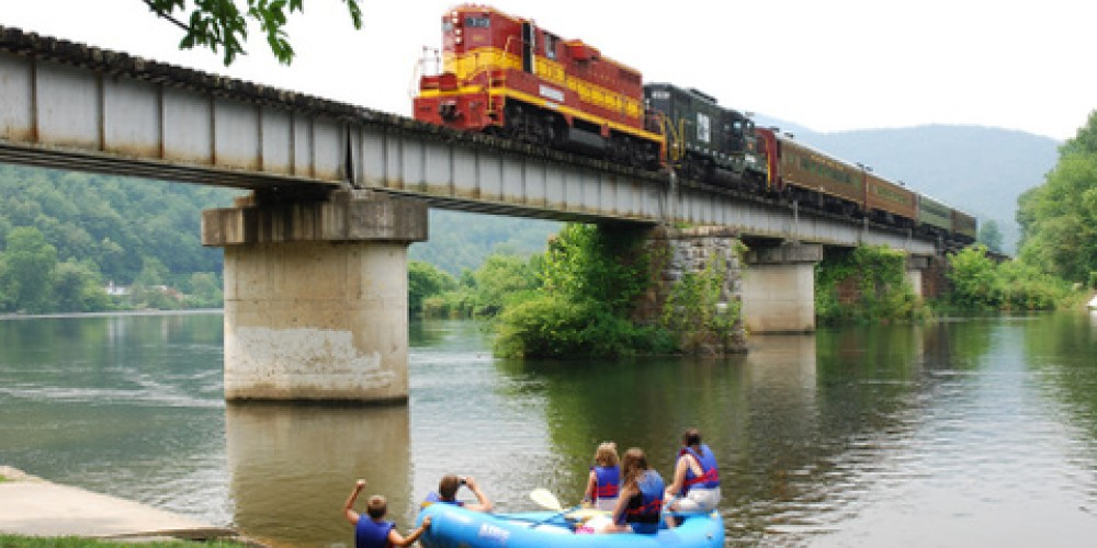 Train crossing bridge in Reliance on Hiwassee River. – Jim Caldwell