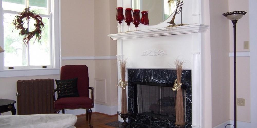 Formal living room with gas-log fireplace. – Radonna Parrish