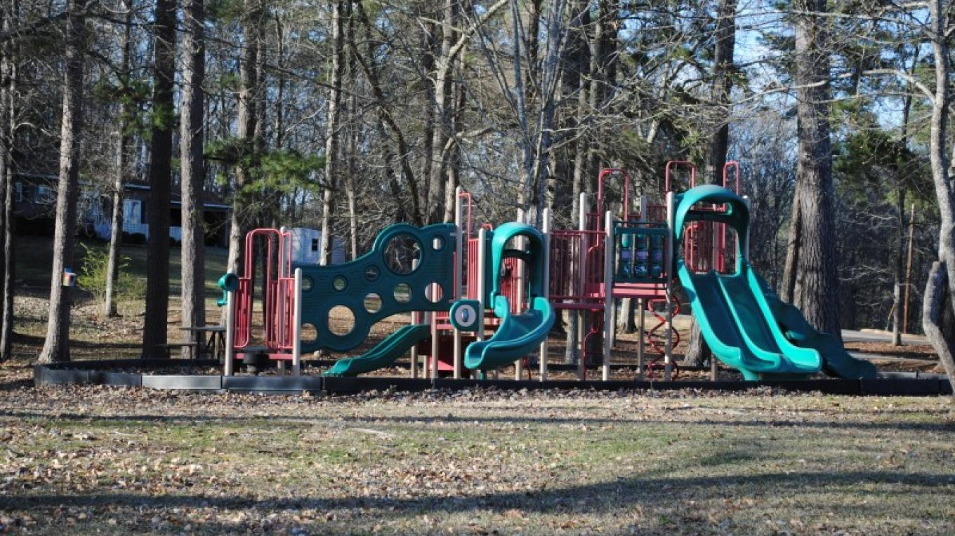 Playground beside tennis courts. – James Gibson