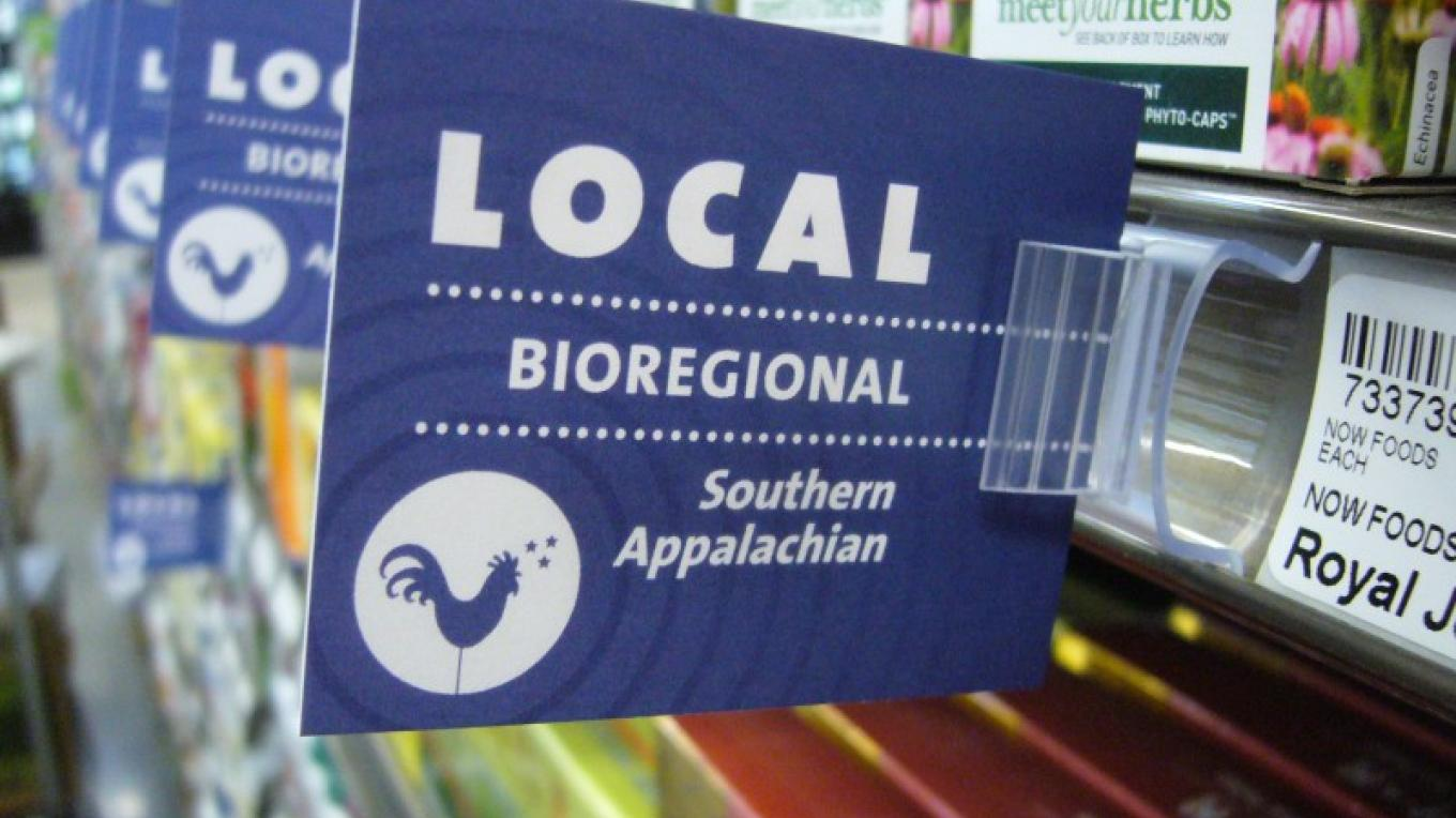 One of the signs in Three Rivers Market designating a product made or grown within their bio-region, the Southern Appalachians. – Three Rivers Market
