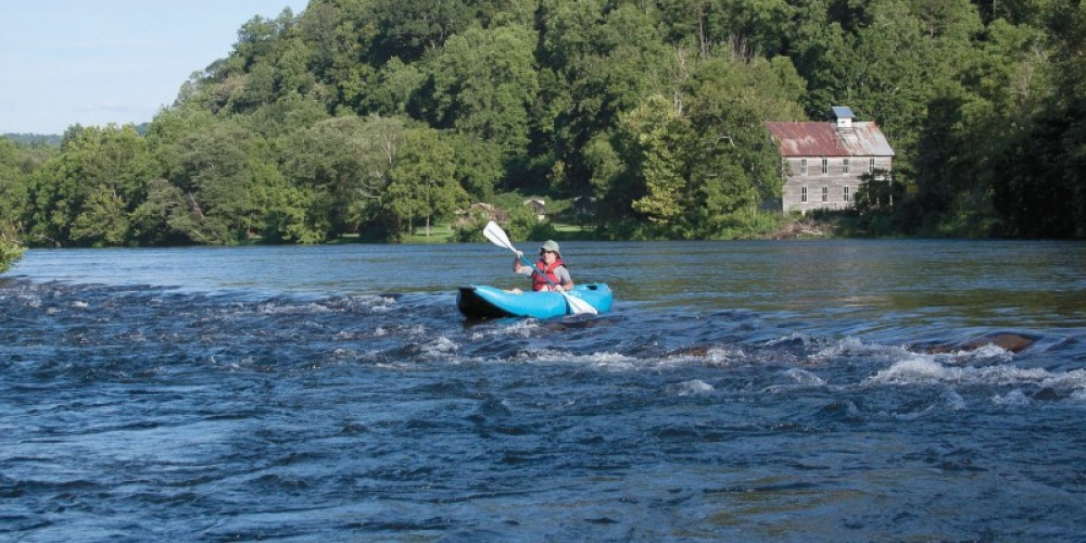 Rafts and funyaks are available for rental.The historic church can be seen at right. – Ingrid Buehler