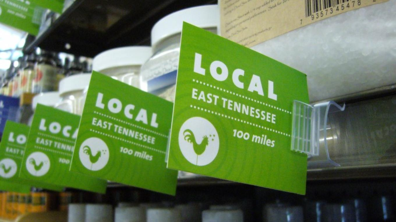 One of the signs in Three Rivers Market designating a product made or grown within 100 miles of Knoxville. – Three Rivers Market