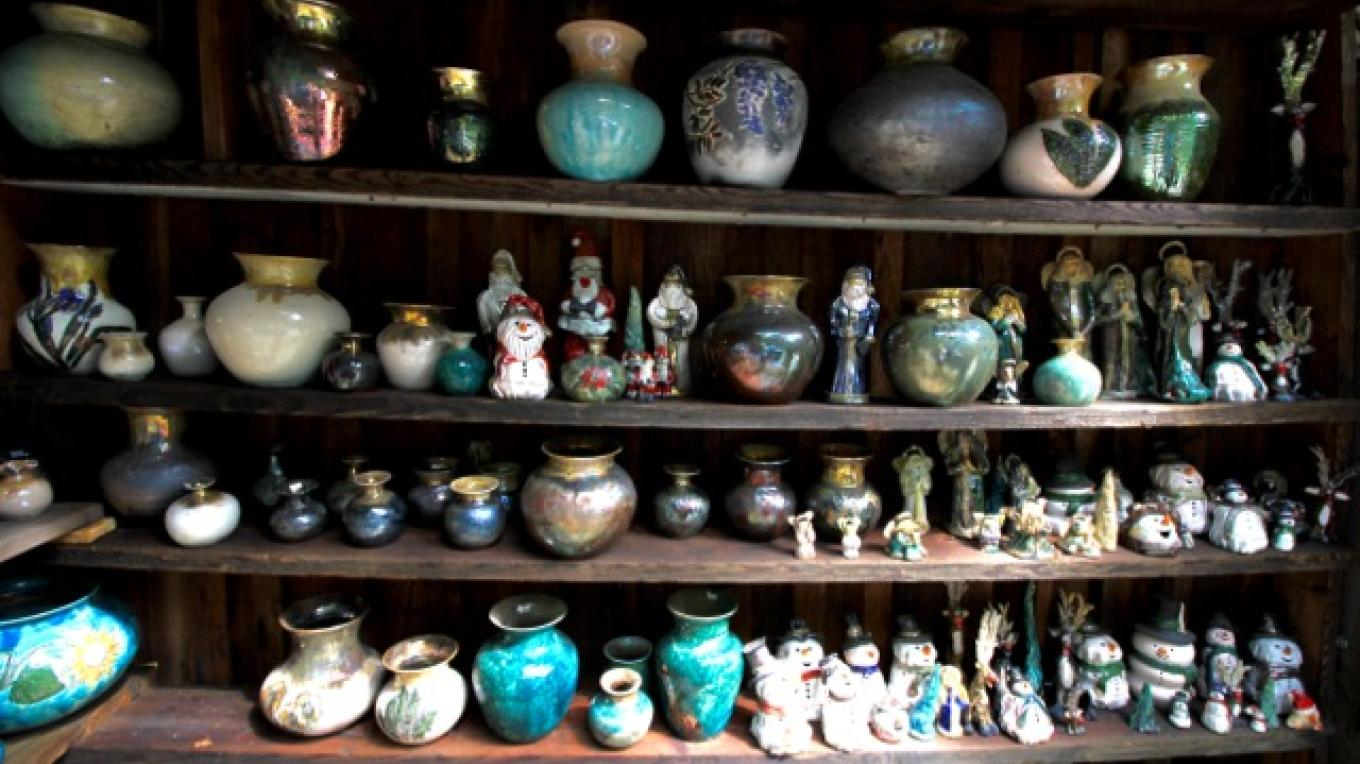 Our visitors shop the outdoor shelves of the pottery's rambling buildings. – Jacob Resor