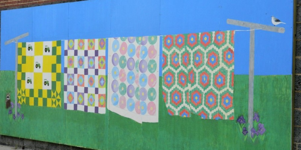 A mural done by students from Chilhowee Middle School flanks the outside courtyard. – Cheryl Maxwell