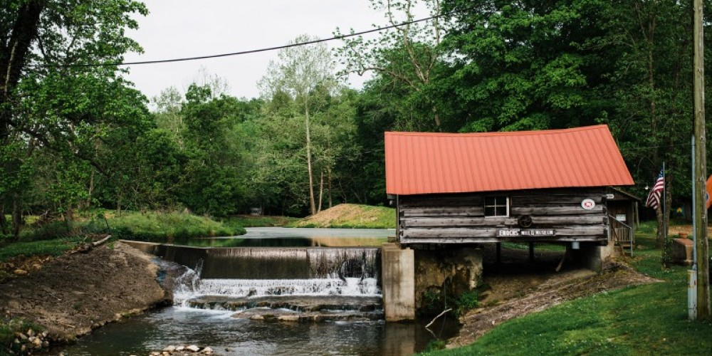 Enochs Mill is a log, plank, and concrete water-powered grist mill and electrical generator built in 1934. – Cari Griffith