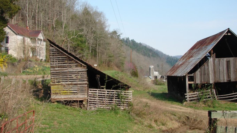The 1880s Vaughn-Webb house, left, overlooks farmland with early farm buildings. – Ingrid Buehler
