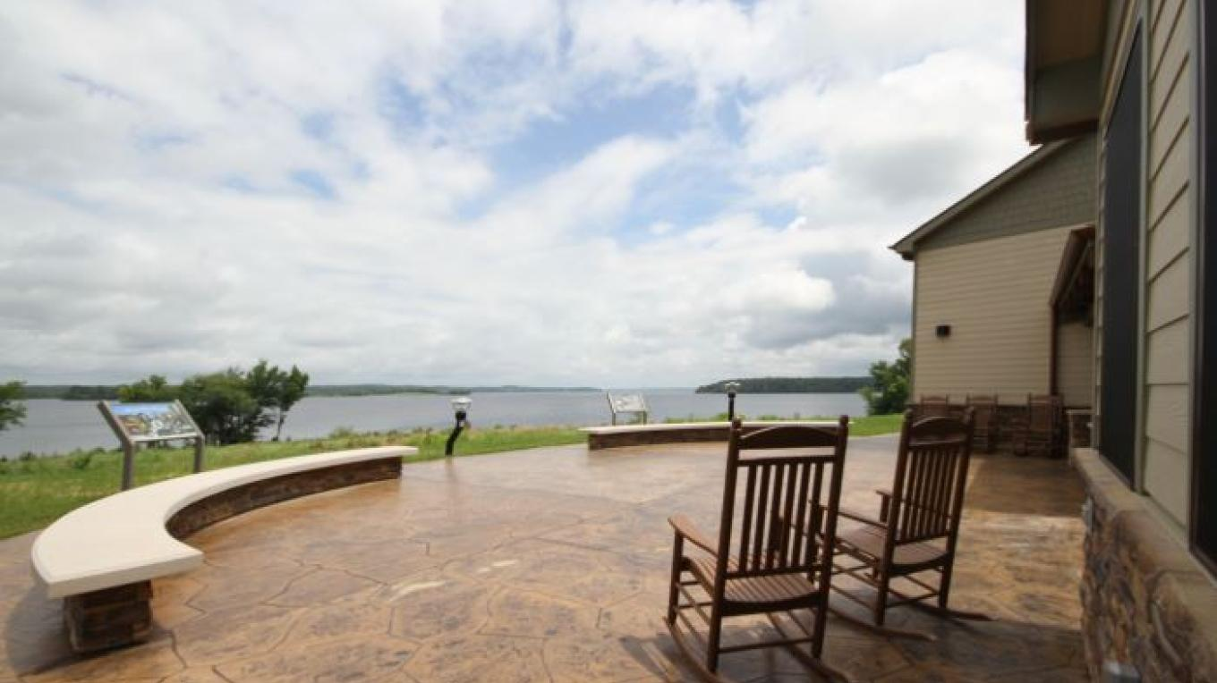 Back patio of Visitor Center overlooking a large bay of Kentucky Lake. – Kimi Fitzhugh