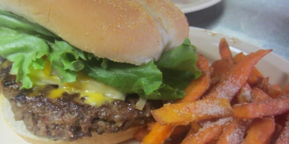 Fresh hand pattied burger with sweet potato fries.