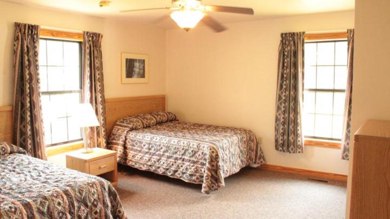 Each cabin's bedroom has two full beds in each of the two bedrooms. The ADA cabin has one full bed in one bedroom and 2 full in the second bedroom.