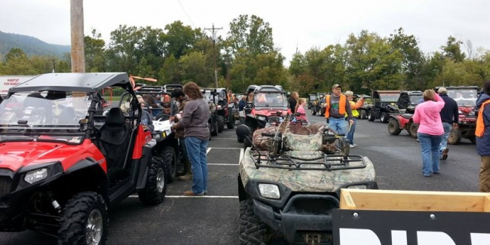 ATV's lined up ready to go on an organized ride.