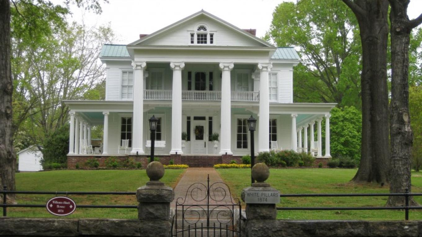 White Pillars, at 320 College Street was constructed in 1874. – Richard Hines
