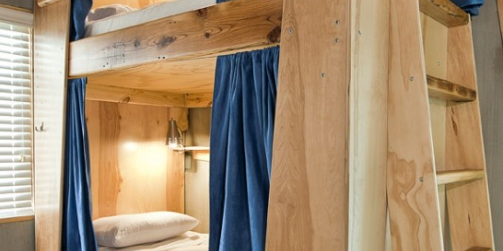Super Bunk:A custom, hand-built, wooden art piece made by Haskel Sears Design, taking the format of a traditional bunk bed and bringing it to a level of style and utility never before seen in a bunk. – Mandy Rhoden