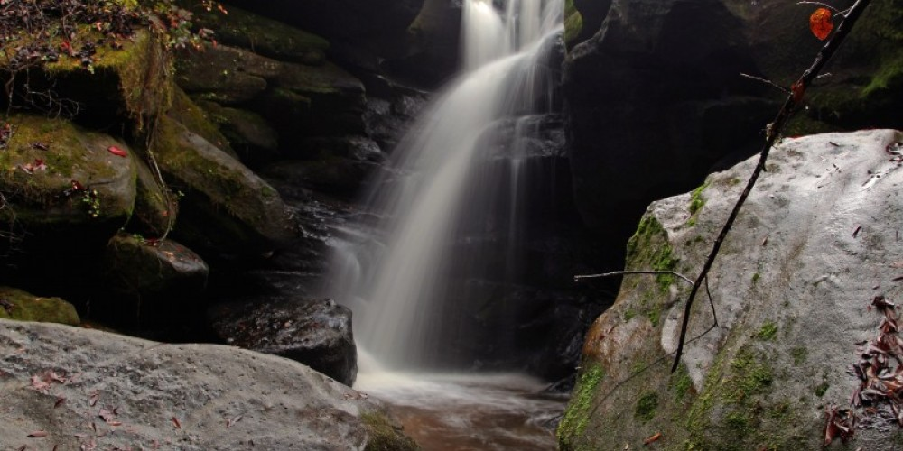 Rainbow Falls is nestled in a small canyon known as The Dismals. – John Dersham